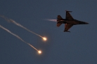 BAF F-16AM solo display dispensing flares in the evening