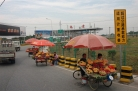 Selling fruit just before the toll gate